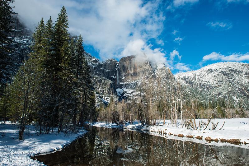 Snow covered cliffs and Yosemite Falls, taken from Swinging Bridge