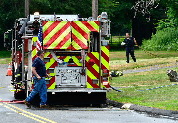 7/17/2019 Mike Orazzi | Staff Firefighters while responding to reports of a fully-involved structure fire at 354 Clark St. Wednesday morning in Southington. The call came in at about 10:20 a.m. The fire department reported heavy flames coming from the front, one side of the home and the rear of the home on arrival.