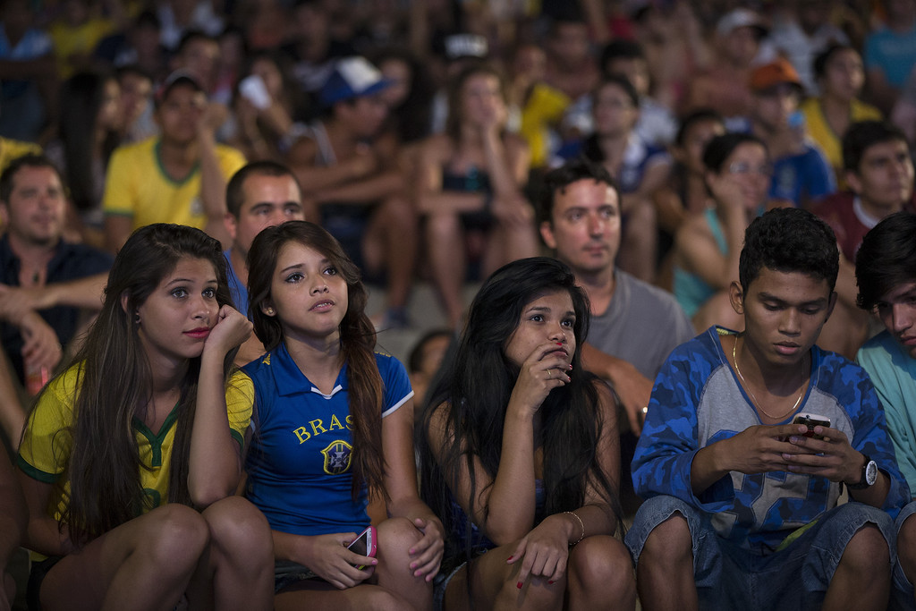 . Football fans watch the FIFA World Cup group match between Argentina and Bosnia Herzegovina in the \'Fan Fest\' area in Ponta Negra on June 15, 2014 in Manaus, Brazil. Group D teams, England lost 2-1 to Italy in their opening match of the 2014 FIFA World Cup in Manaus on June 14, 2014.  (Photo by Oli Scarff/Getty Images)