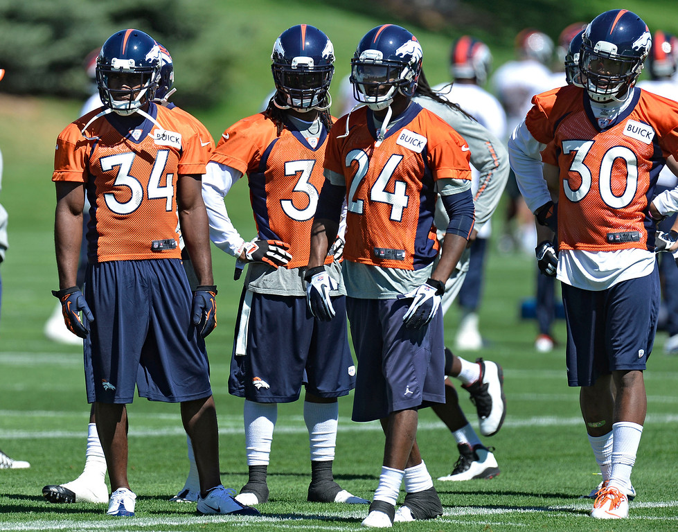 . Denver Broncos Quentin Jammer (34) Omar Bolden (31) Champ Bailey (24) David Bruton (30) look on during drills during OTA\'s May 30, 2013 at Dove Valley. (Photo By John Leyba/The Denver Post)
