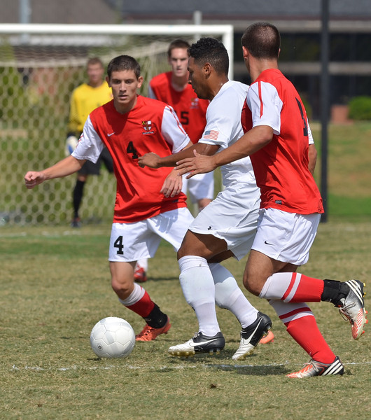 Ethan Senger (34) battles to keep the ball from his opponents.