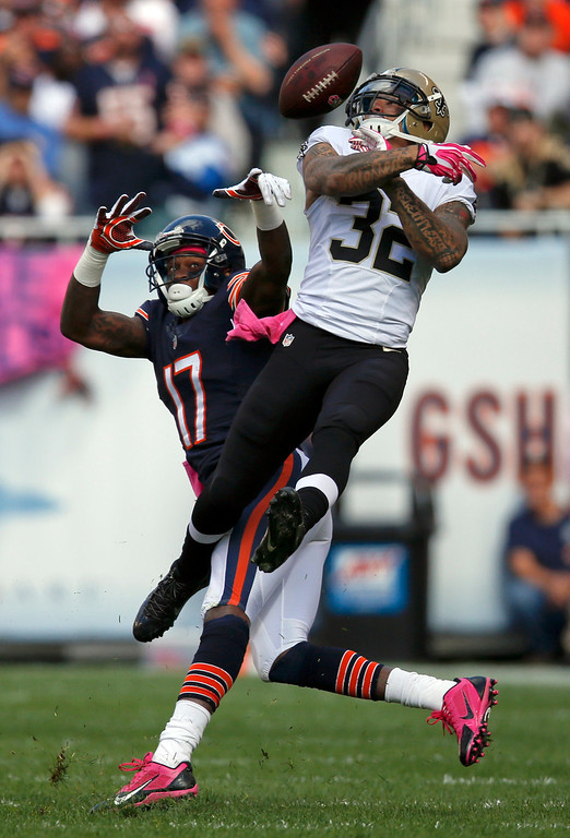 . New Orleans Saints strong safety Kenny Vaccaro (32) breaks up a pass intended for Chicago Bears wide receiver Alshon Jeffery (17) during the first half of an NFL football game, Sunday, Oct. 6, 2013, in Chicago. (AP Photo/Charles Rex Arbogast)