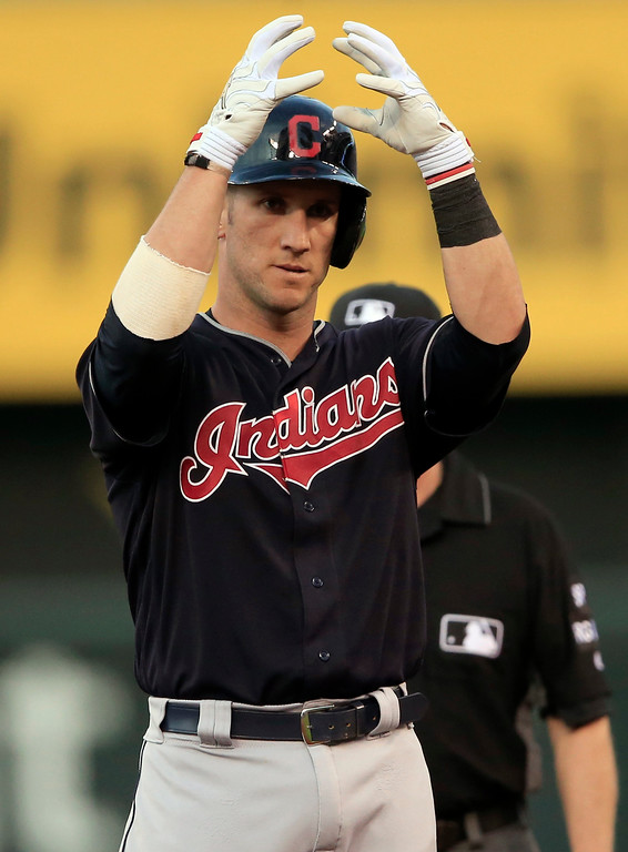 . Cleveland Indians\' Yan Gomes gestures to teammates after a double off Kansas City Royals starting pitcher Jason Vargas during the fifth inning of a baseball game at Kauffman Stadium in Kansas City, Mo., Friday, June 2, 2017. (AP Photo/Orlin Wagner)