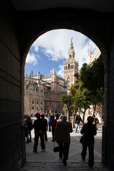 The Cathedral and the Giralda Tower as seen through the Patio de Banderas archway. Seville, Spain