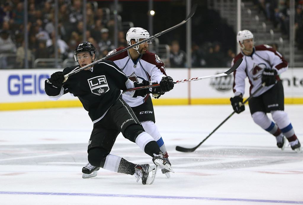. LOS ANGELES, CA - NOVEMBER 23:  Tanner Pearson #70 of the Los Angeles Kings falls from a shove by Maxime Talbot #25 of the Colorado Avalanche in the first period during the NHL game at Staples Center on November 23, 2013 in Los Angeles, California.  (Photo by Victor Decolongon/Getty Images)