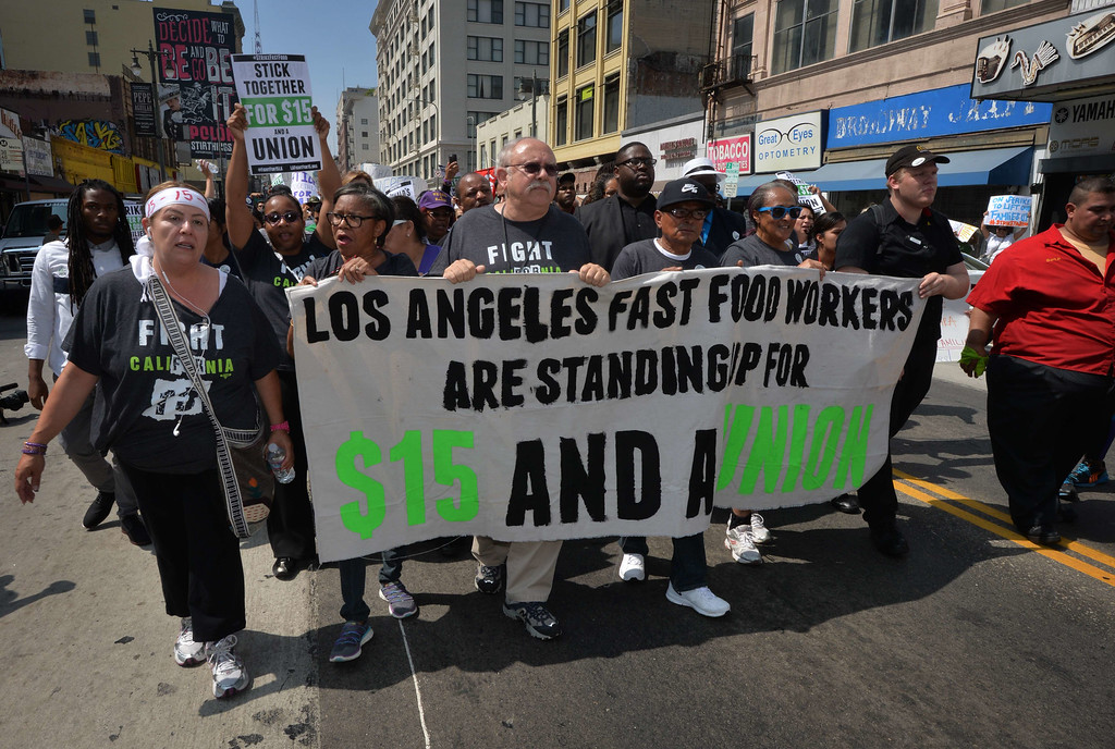 . Fast food workers march towards a downtown McDonald\'s restaurant during a demonstration against low wages in Los Angeles on September 04, 2014.  A dozen protesters were arrested during the demonstration which  is part of a series of nationwide protests calling for higher wages for fast-food restaurant workers.       AFP PHOTO/Mark RALSTONMARK RALSTON/AFP/Getty Images
