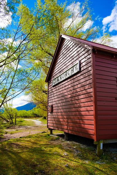 Distinctive red boathouse on the shore of Lake Wakatipu, Glenorchy, South Island, New Zealand
