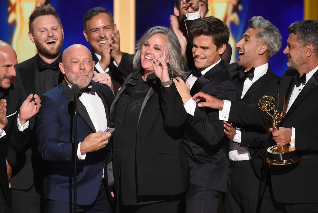 ". The team from ""Queer Eye\"" accept the award for outstanding structured reality program during night two of the Television Academy\'s 2018 Creative Arts Emmy Awards at the Microsoft Theater on Sunday, Sept. 9, 2018, in Los Angeles. (Photo by Phil McCarten/Invision/AP)"