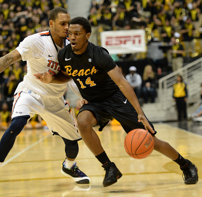 . Long Beach\'s Branford Jones (14) drives the ball down to the key against Fullerton in a Big West mens basketball game at the Pyramid Saturday, February 01, 2014, Long Beach CA.   Long Beach won 75-56. CSU Long Beach versus CSU Fullerton Photo by Steve McCrank/Daily Breeze