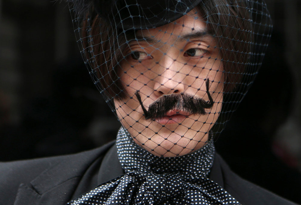 Description of . Fashion writer Yu Masui poses for a photograph outside Somerset House during London Fashion Week, February 15, 2013. REUTERS/Suzanne Plunkett