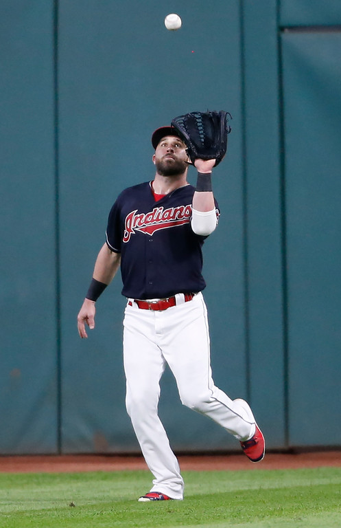 . Cleveland Indians\' Jason Kipnis makes a catch to get out Detroit Tigers\' Nicholas Castellanos during the fifth inning of a baseball game, Friday, Sept. 14, 2018, in Cleveland. (AP Photo/Ron Schwane)