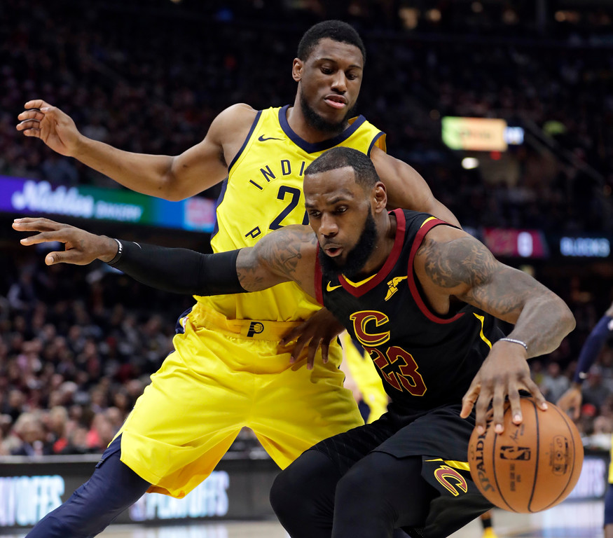 . Cleveland Cavaliers\' LeBron James, right, drives against Indiana Pacers\' Thaddeus Young during the first half of Game 2 of an NBA basketball first-round playoff series Wednesday, April 18, 2018, in Cleveland. (AP Photo/Tony Dejak)