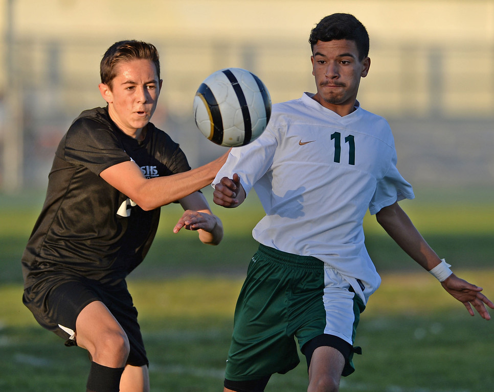 . Narbonne\'s Alvarado Jeovanni (11) keeps the ball from San Pedro\'s Evan Butler (24) in a Marine League boys soccer game Wednesday, February 12, 2014, Harbor City, CA.  Narbonne won 2-0 and seals the league title. Photo by Steve McCrank/Daily Breeze