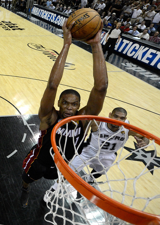 . Chris Bosh #1 of the Miami Heat goes up for a shot against Tim Duncan #21 of the San Antonio Spurs in the first half during Game Four of the 2013 NBA Finals at the AT&T Center on June 13, 2013 in San Antonio, Texas.   (Photo by Derick E. Hingle/Pool/Getty Images)