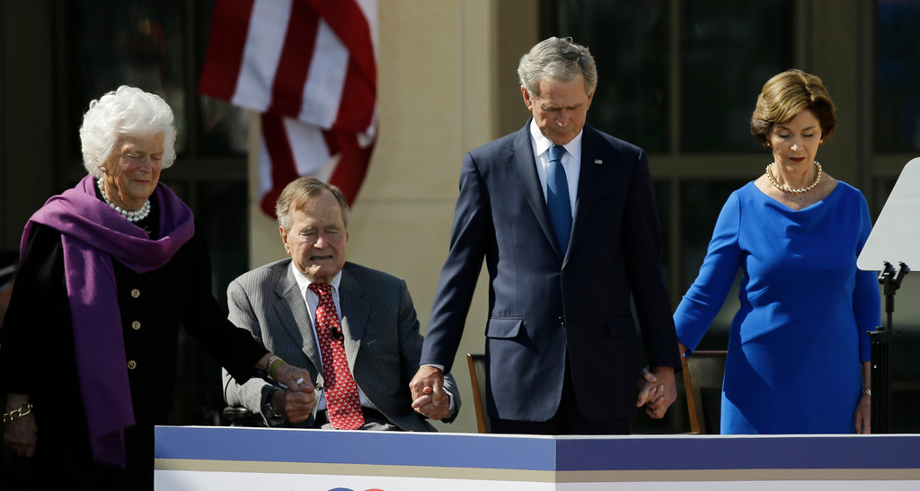 . From left, former first lady Barbara Bush, President George H.W. Bush, former president George W. Bush and former first lady Laura Bush holds hands during the invocationduring the dedication of the George W. Bush Presidential Center Thursday, April 25, 2013, in Dallas. (AP Photo/David J. Phillip)