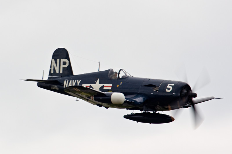 F4U Corsair with an early radar pod on the starboard wing.
