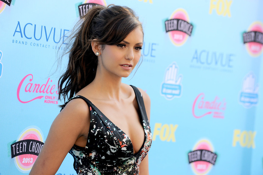 . Nina Dobrev arrives at the Teen Choice Awards at the Gibson Amphitheater on Sunday, Aug. 11, 2013, in Los Angeles. (Photo by Jordan Strauss/Invision/AP)
