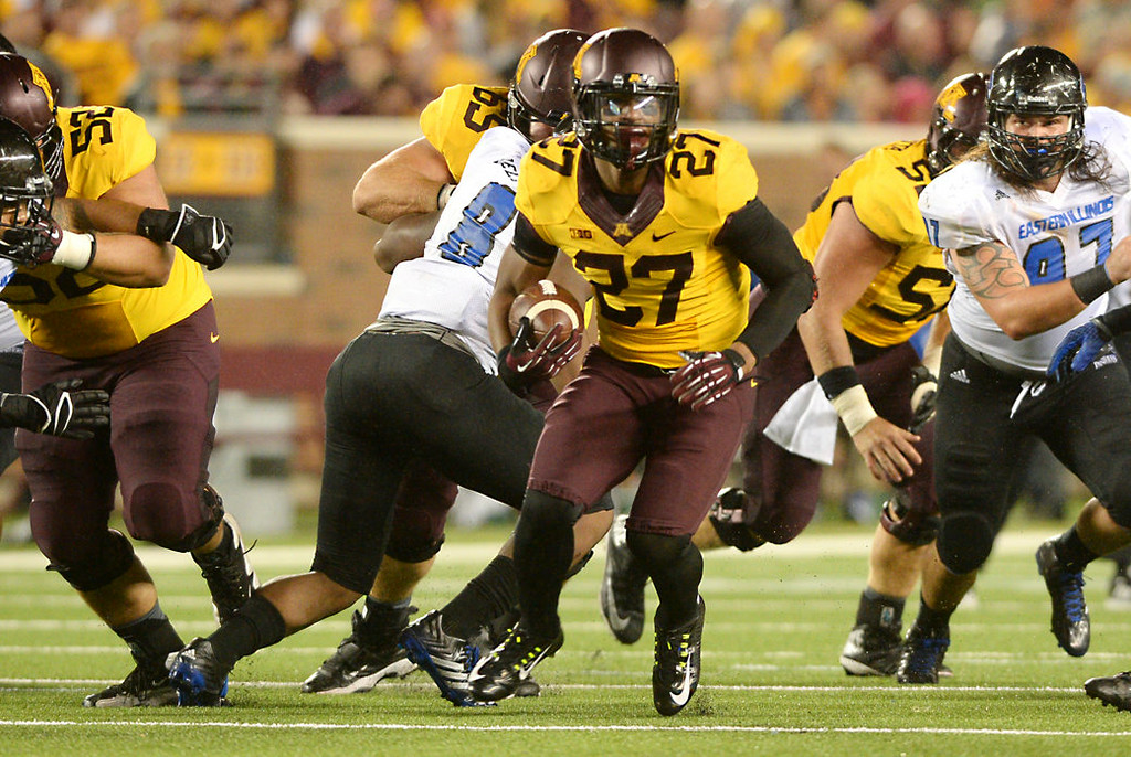 . Minnesota running back David Cobb rushes for a first down against Eastern Illinois in the third quarter. (Pioneer Press: John Autey)