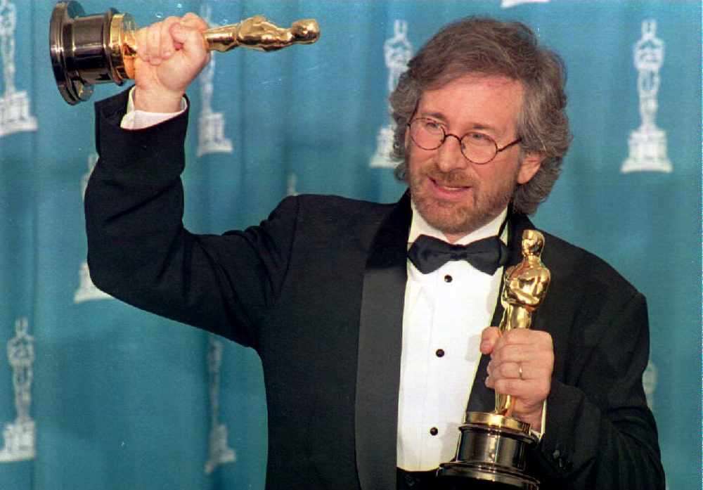 Description of . US director Steven Spielberg poses with his two Oscars 21 March 1994 in Los Angeles, CA during the 66th Annual Academy Awards ceremony after winning the 1993 wards for best director and best picture for his movie