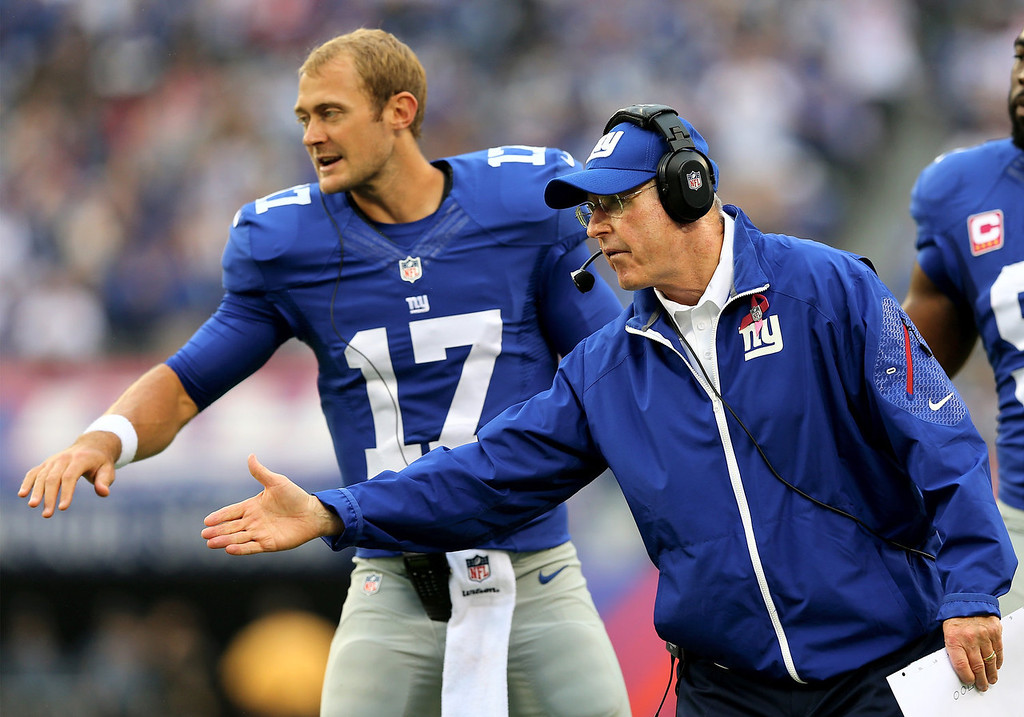 . Head coach Tom Coughlin of the New York Giants celebrates the touchdown with his players in the first quarter against the Philadelphia Eagles at MetLife Stadium on October 6, 2013 in East Rutherford, New Jersey.  (Photo by Elsa/Getty Images)