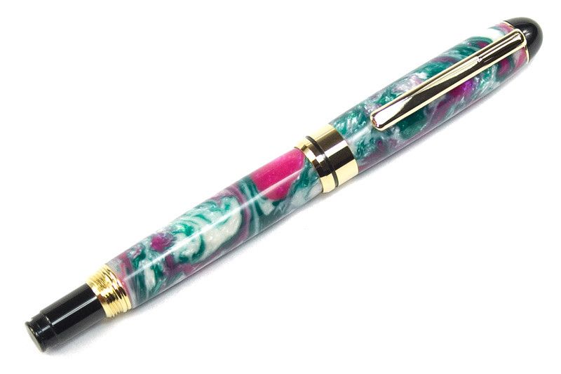 Round Top 8mm Euro Gold Fountain Pen shown with Karma Lava Explosion acrylic