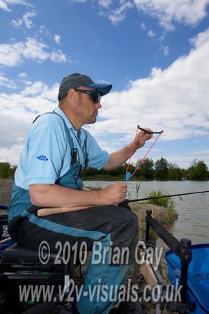 Preparing to feed. Brian Gay fishing the Pellet Waggler at Trinity Waters, Woodland Lake, 280510. © 2010 Brian Gay