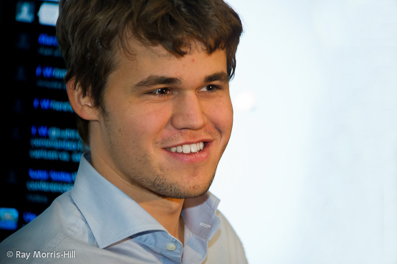 Magnus Carlsen just realises he has won the tournament, as messages of congratulation appear on the screen in the press room.