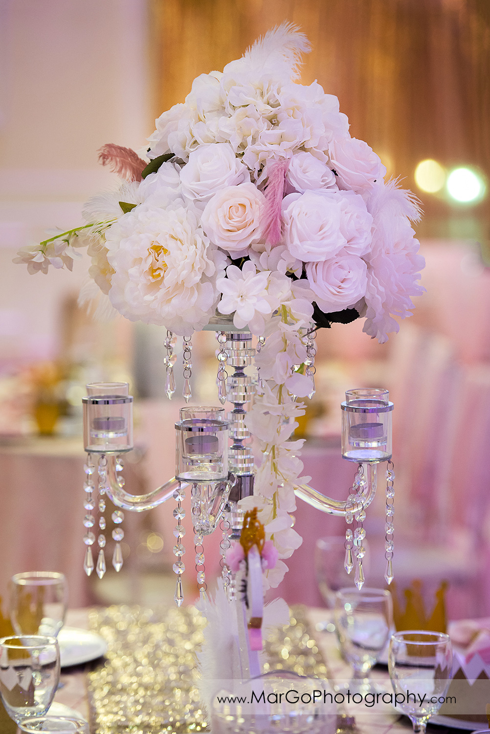 white flower centerpiece at Newark Oasis Palace
