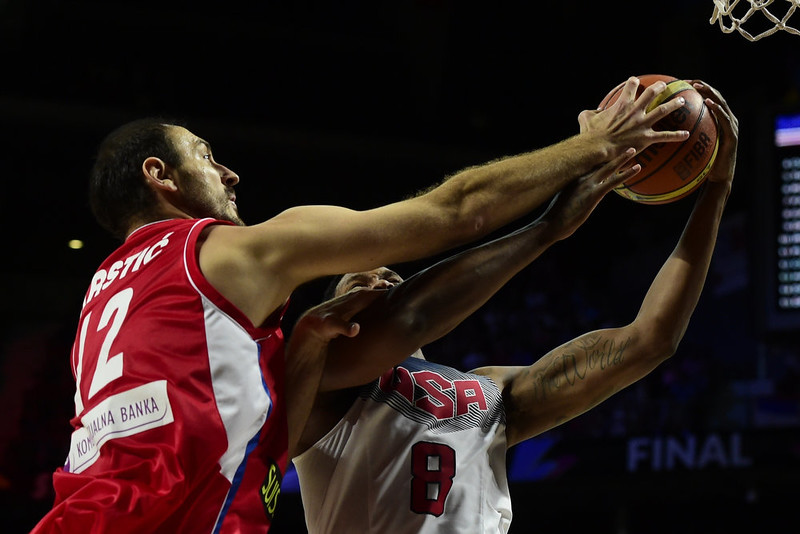 . US forward Rudy Gay (R) vies with Serbia\'s centre Nenad Krstic during the 2014 FIBA World basketball championships final match USA vs Serbia at the Palacio de los Deportes in Madrid on September 14, 2014.   JAVIER SORIANO/AFP/Getty Images
