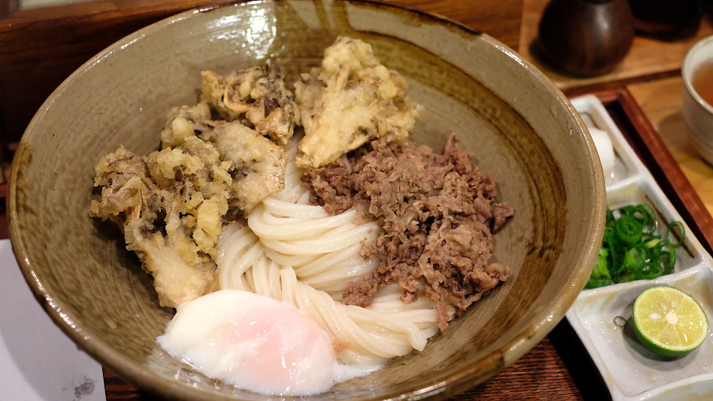 Bukkake udon with maitake tempura, simmered beef, and a soft-boiled egg.