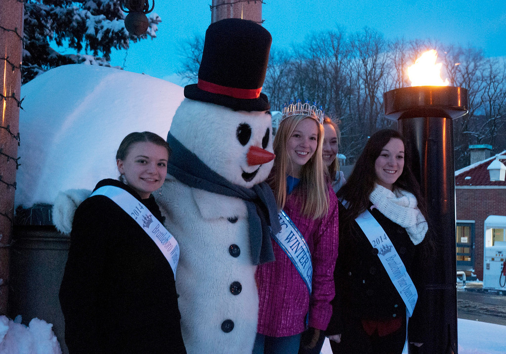 . Kayla Rice/Reformer Brattleboro Winter Carnival\'s 2013 Queen, Allison Cornellier stands with three of the 2014 Queen\'s Pageant participants and Frosty the Snowman during the torch lighting ceremony at Well\'s Fountain in Brattleboro on Friday.