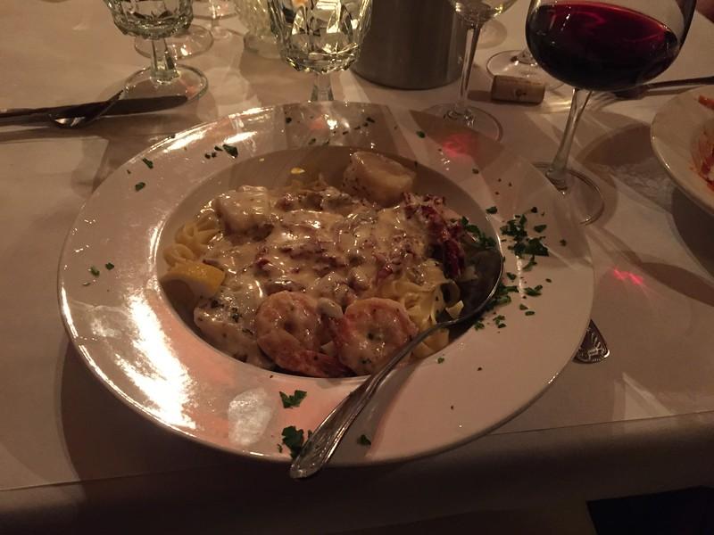 Seared scallops, shrimp and fish w/sundried tomoatoes on fettucine.