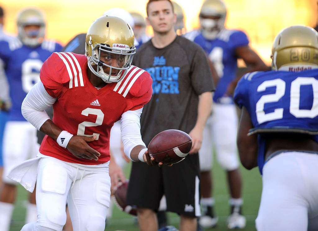 . UCLA quarterback Asiantii Woulard during spring practice Monday April 7, 2014 at UCLA.(Andy Holzman/Los Angeles Daily News)