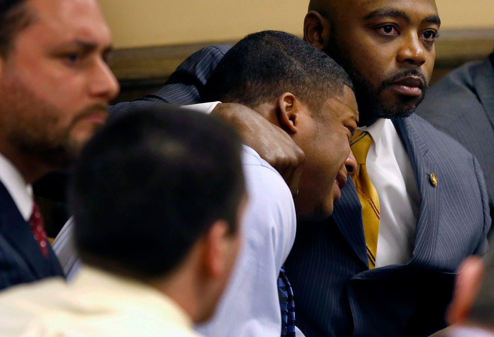 . Defense attorney Walter Madison (R) comforts Ma\'lik Richmond (L) as Richmond reacts to the verdict during his trial at the juvenile court in Steubenville, Ohio March 17, 2013. Two high school football players from Ohio, Trent Mays, 17, and Richmond, 16, were found guilty of raping a 16-year-old girl at a party last summer while she was in a drunken stupor in a case that gained national exposure through social media. REUTERS/Keith Srakocic/Pool