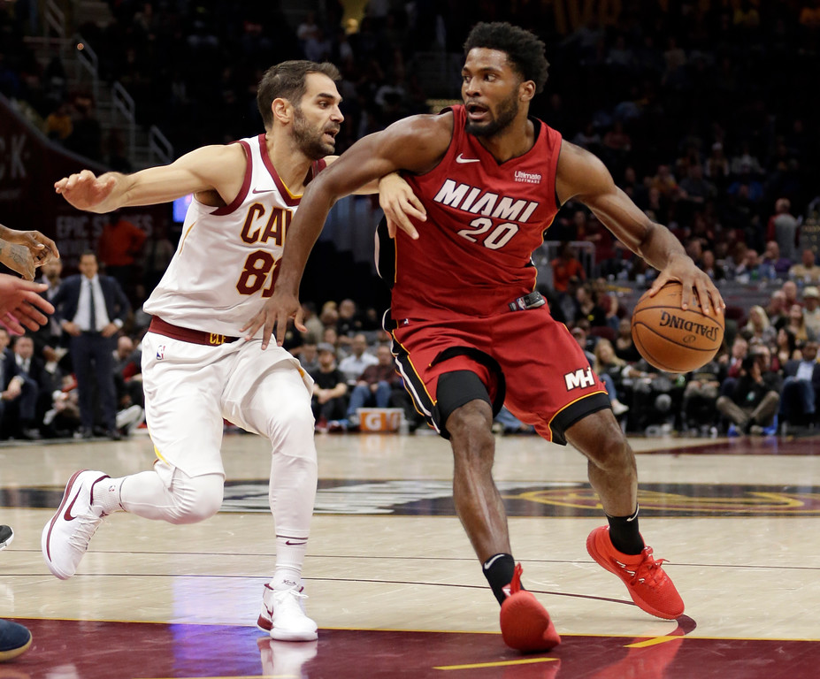. Miami Heat\'s Justise Winslow, right, drives against Cleveland Cavaliers\' Jose Calderon (81), from Spain, in the second half of an NBA basketball game, Tuesday, Nov. 28, 2017, in Cleveland. The Cavaliers won 108-97. (AP Photo/Tony Dejak)