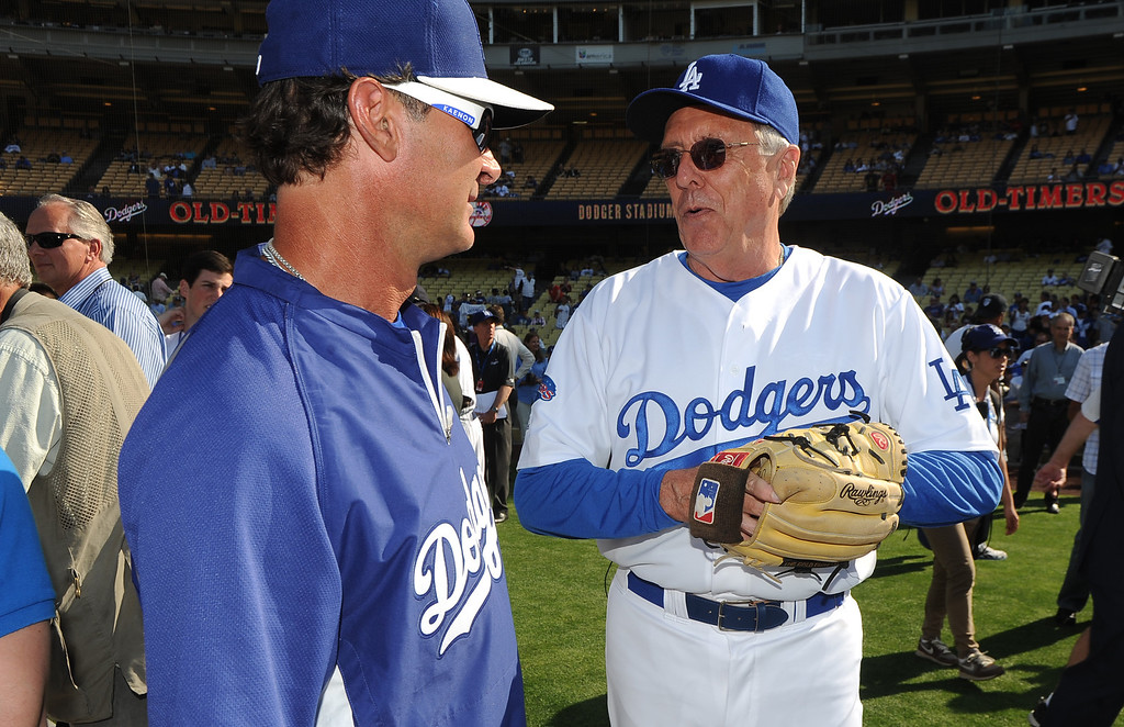 . Los Angeles Dodgers manager Don Mattingly, left, with former Los Angeles Dodgers Rick Monday during the Old-Timers game prior to a baseball game between the Atlanta Braves and the Los Angeles Dodgers on Saturday, June 8, 2013 in Los Angeles. 