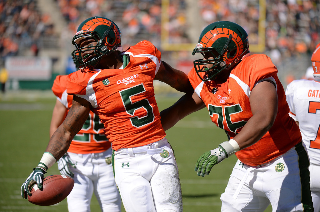 . FORT COLLINS, CO - September 28 : RB Kapri Bibbs of Colorado State University (5) celebrates his touchdown with Brandon Haynes (75) in the 2nd quarter of the game against University of Texas at El Paso at Hughes Stadium. Fort Collins, Colorado. September 28, 2013. (Photo by Hyoung Chang/The Denver Post)