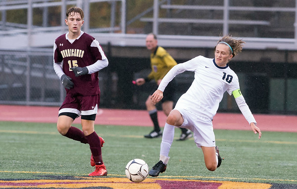 10/29/19 Wesley Bunnell | StaffrrNew Britain soccer was defeated 2-0 by Newington during a drizzle at Veterans Stadium on Tuesday afternoon. New Britain's Cameron Naples (15) and Newington's Trey Sadler (10).