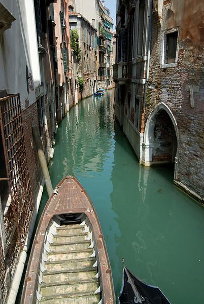 Riding the gondola through narrow alleys in Venice, Italy