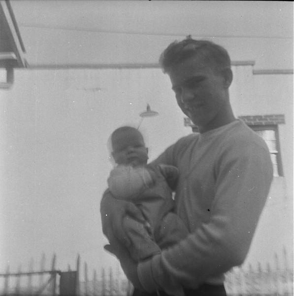 Alex Bondar holding Jeff Grant - Peru, Indiana - 1956