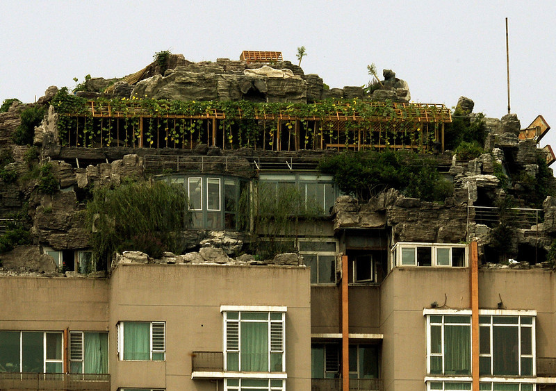 . A rooftop apartment surrounded by imitation rocks that is the subject of controversy after it was declared illegal in Beijing on August 13, 2013.  An eccentric Beijing resident has built a huge house among what looks like a pile of rocks dotted with trees on top of a 26-storey apartment block in the capital.   MARK RALSTON/AFP/Getty Images