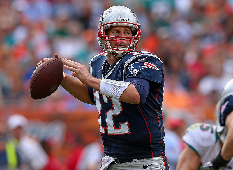 . Tom Brady #12 of the New England Patriots passes during a game against the Miami Dolphins at Sun Life Stadium on December 2, 2012 in Miami Gardens, Florida.  (Photo by Mike Ehrmann/Getty Images)