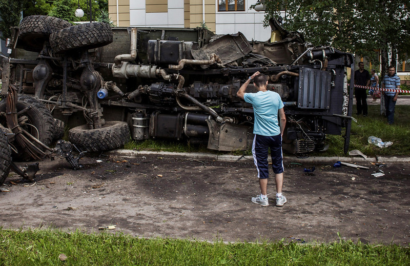 . A Ukrainian man stands in front of a destroyed truck, which was previously used by pro-Russian militants and which was bombed by Ukrainian army soldiers overnight during clashes, in the eastern Ukrainian city of Donetsk, on May 27, 2014. Ukraine said today it had regained control of the airport in the eastern city of Donetsk after a day of punishing air strikes and fierce fighting with pro-Moscow separatist gunmen left dozens of people dead. (FABIO BUCCIARELLI/AFP/Getty Images)