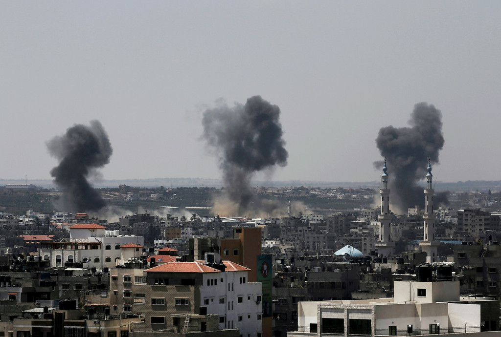 . Smoke rises after Israeli missile strikes hit the northern Gaza Strip, Wednesday, July 16, 2014. A Hamas website says Israel has fired missiles at the homes of four of its senior leaders as it resumed bombardment of Gaza, following a failed Egyptian cease-fire effort. Wednesday\'s bombings came after Hamas rejected an Egyptian truce proposal on Tuesday and instead launched more rockets at Israel. (AP Photo/Adel Hana)