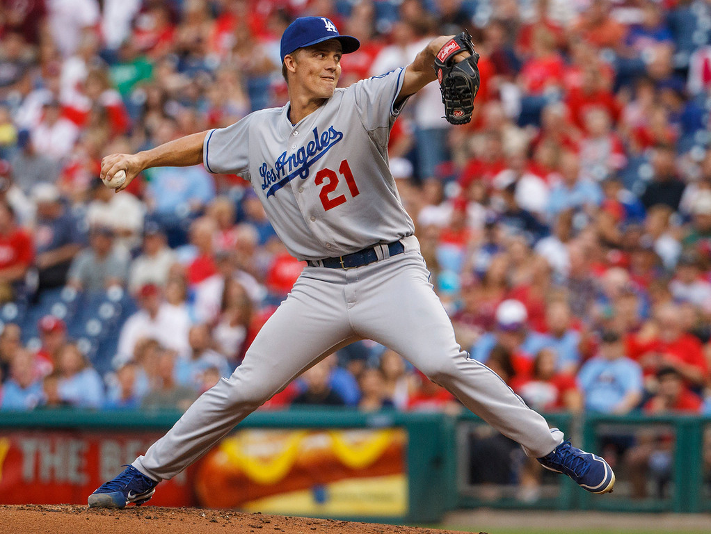 . Los Angeles Dodgers starting pitcher Zack Greinke throws to the Philadelphia Phillies during the first inning of a baseball game on Friday, Aug. 16, 2013, in Philadelphia. (AP Photo/Christopher Szagola)