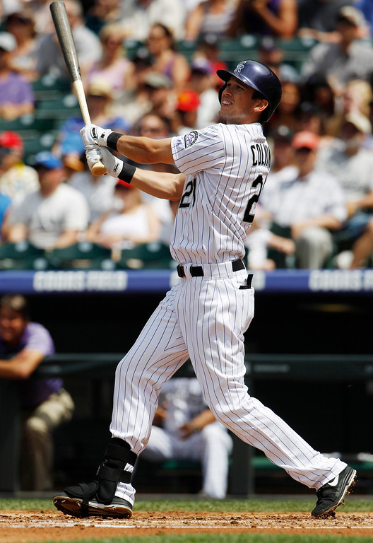 . Colorado Rockies\' Tyler Colvin follows the flight of his two-run home run against the Philadelphia Phillies in the first inning of a baseball game in Denver, Saturday, June 15, 2013. (AP Photo/David Zalubowski)