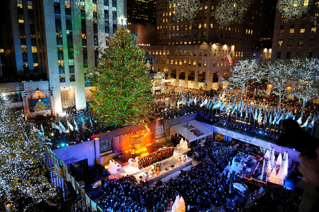 . The 74-foot-tall Rockefeller Center Christmas Tree is lit by 30,000 energy efficient LED lights in the 79th annual lighting ceremony, Wednesday, Nov. 30, 2011 in New York.  (AP Photo/Henny Ray Abrams)