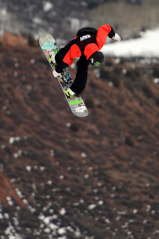 . ASPEN, CO - JANUARY 26: Gjemund Braaten hits a jump during the men\'s snowboard slopestyle final. X Games Aspen Buettermilk Mountain Aspen January 26, 2013 (Photo By AAron Ontiveroz / The Denver Post)