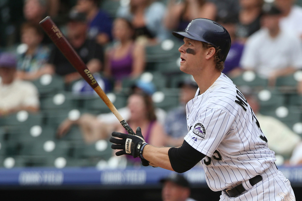 . Colorado Rockies\' Justin Morneau follows the flight of his two-run, walkoff home run against the San Diego Padres in the 10th inning of the Rockies\' 8-6 victory in 10 innings of a baseball game in Denver on Sunday, May 18, 2014. (AP Photo/David Zalubowski)