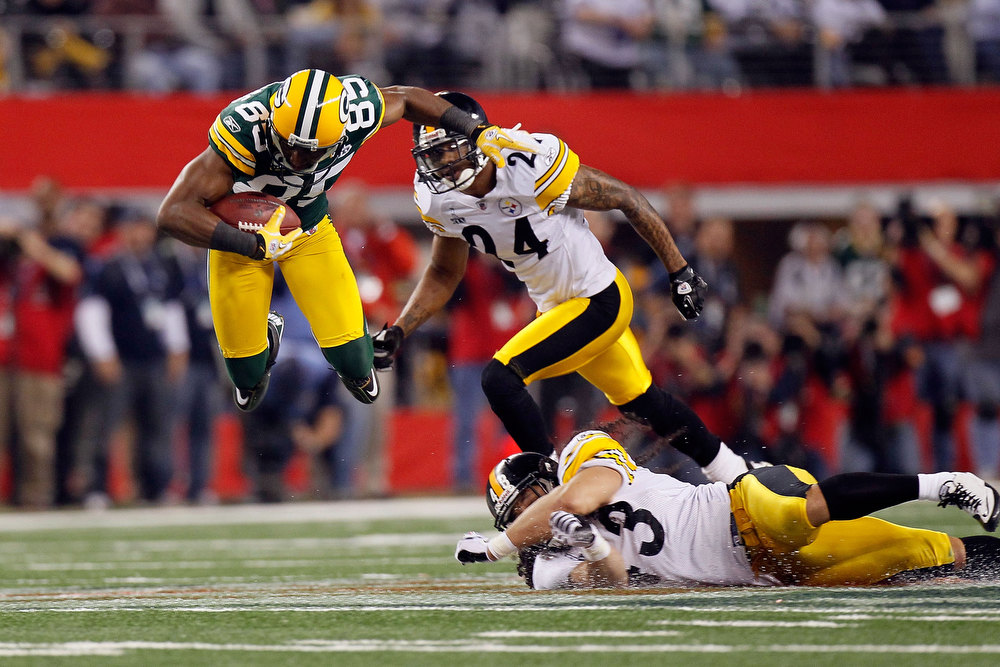 Description of . Greg Jennings #85 of the Green Bay Packers catches a 31 yard pass in the fourth quarter against the Pittsburgh Steelers during Super Bowl XLV at Cowboys Stadium on February 6, 2011 in Arlington, Texas.  (Photo by Kevin C. Cox/Getty Images)